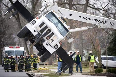 Two Large Mobile Cranes Were Brought In To Lower The Boom Truck Crane Back Into Upright Position This Time Damage Was Slight And Man