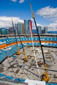 Pacific Blasting & Demolition taking down the last roof cables at BC Place, Vancouver using 3 cranes to disperse the weight and control the cable lowering for removal