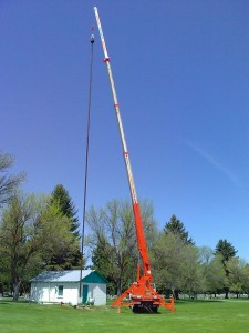 Crane pulling out a complete deep well turbine pump in one piece. It is from a local cemetery and is about 110' deep