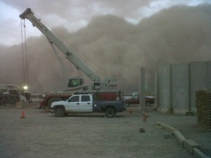 Sand storm in Iraq rolling in with an AC-50 and 60 ton Link-belt RT in the foreground