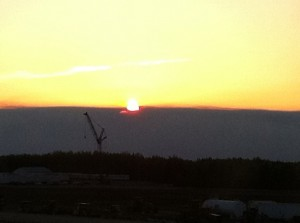 You can see the clear separation of clear sky and smoke/ash layer as the sun sets near Slave Lake