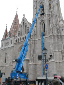 Budapest, Hungary. Terex AC 40 City crane lift a big bell (6800 lbs) , into the window of a Matthias church's tower. They carved the window onto the shape of the bell, only some inches of gap remained between the window and the bell
