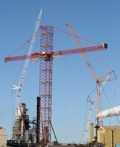 Northern Crane Services' erection of the KROLL 10,000 at Syncrude in Fort McMurray. The Kroll tower crane has a jib height and max radius of 337 feet with a lifting capacity of 100 tonnes at the tip and a reach that extends to 7.5 acres, which is more than the area of six football fields