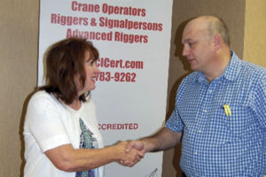 Debbie Dickinson, executive director of CIC, congratulates Tim Edwards on his election to the committee