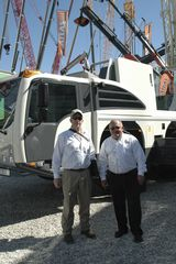 Allan Woodruff of Scott-Macon Equipment and Mark Phillippi of Terex take a look at the new Terex Exporer AT prototype on the Terex stand at Bauma.
