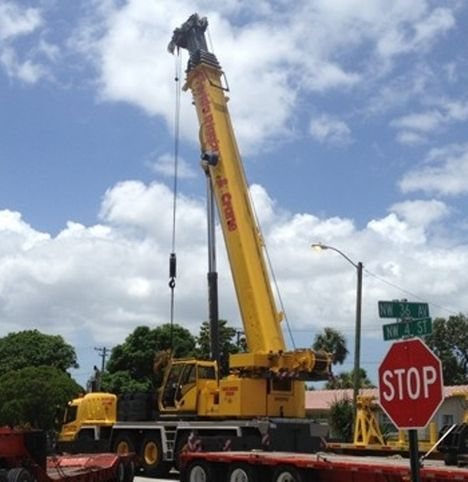 The crane with the boom retracted after the incident