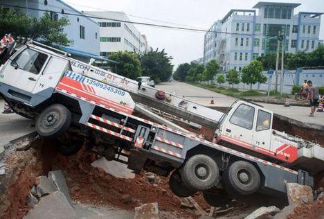 Sinkhole takes crane
