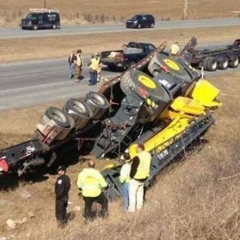 Trailer flips with crane A