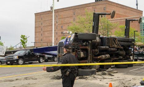 Boom Truck overturns 3