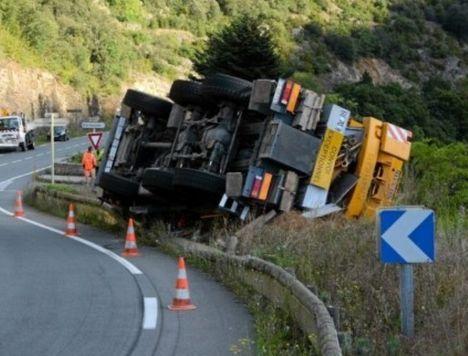 Crane rolls on mountain road 1