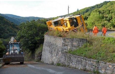 Crane rolls on mountain road 2