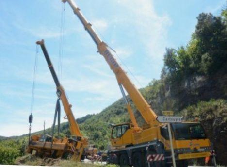Crane rolls on mountain road 3