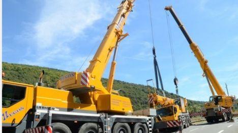 Crane rolls on mountain road 4
